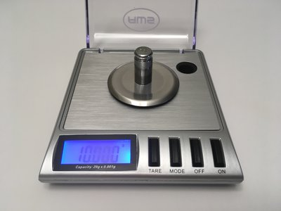 how to calibrate a digital scale with coins