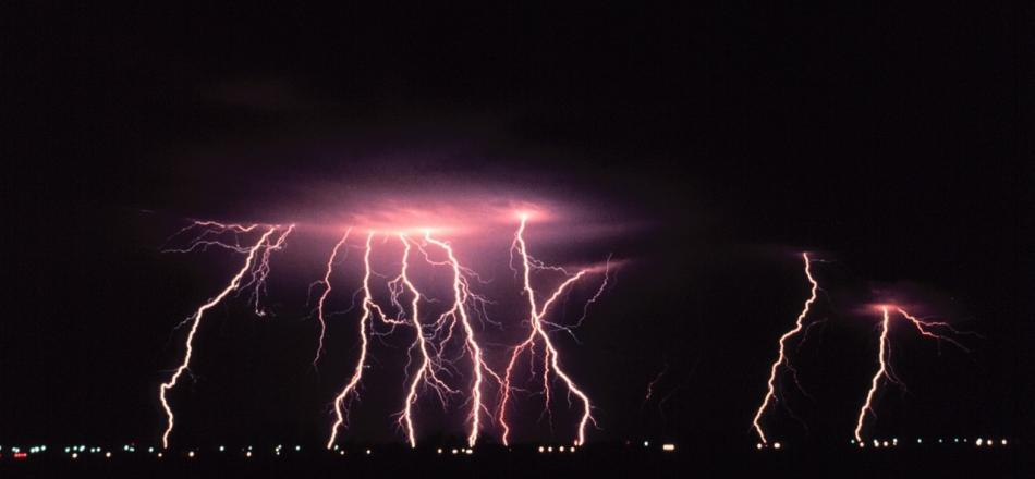 lightning striking in night sky