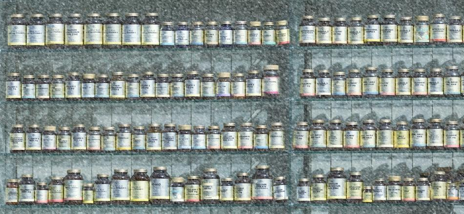 shelves with bottles of supplements