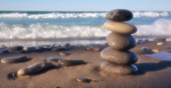 pile of rocks balanced on a beach